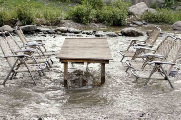 2013-08-03_03_River Side Cafe Table Chairs in Water