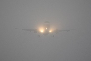 A plane lands in thick fog today at Heathrow Airport. PRESS ASSOCIATION Photo. Picture date: Tuesday November 22, 2011. Photo credit should read: Steve Parsons/PA Wire